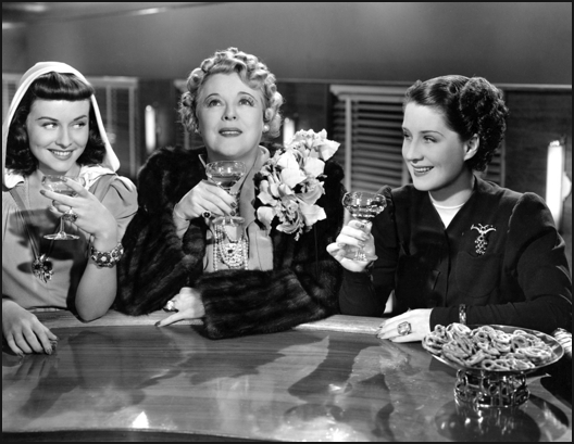 Paulette Goddard, Mary Boland y Norma Shearer en Mujeres