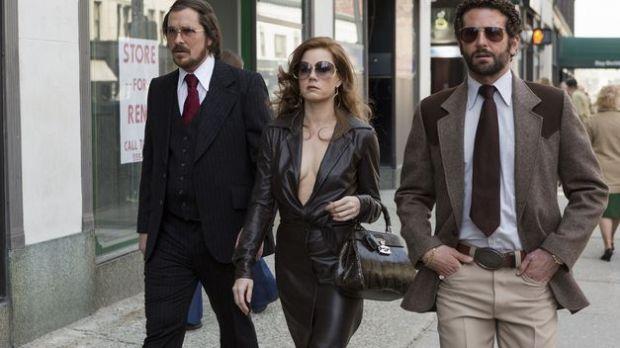 Christian Bale, Amy Adams y Bradley Cooper en La Gran Estafa Americana