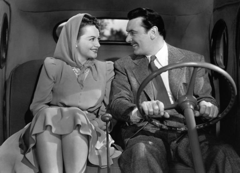 Olivia de Havilland y George Brent en Como Ella Sola