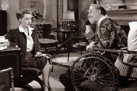 Bette davis y Monty Woolley en El Hombre que Vino a Cenar