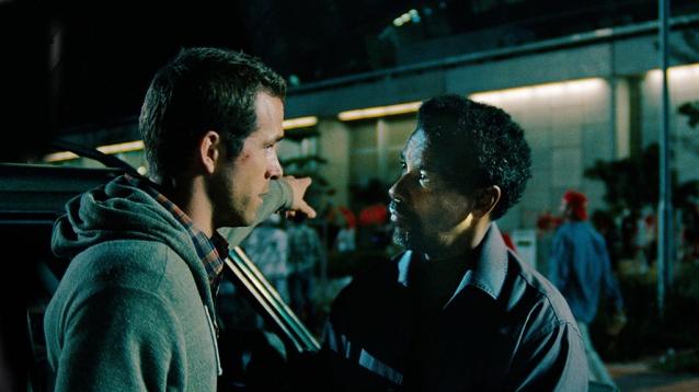 Ryan Reynolds y Denzel Washington en El Invitado